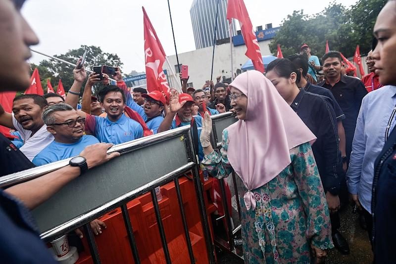 Deputy Prime Minister Datuk Seri Dr Wan Azizah Wan Ismail greats supporters outside the nomination centre for the Seri Setia by-election in Petaling Jaya August 18, 2018. — Picture by Hari Anggara