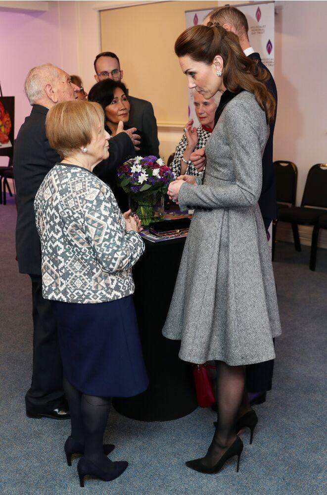 Kate Middleton (right) speaking with survivor Mala Tribich | Chris Jackson/Getty