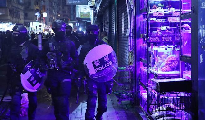 Police officers from the Special Tactical Squad, also known as Raptors, in Mong Kok. Hong Kong has seen its worst civil unrest in decades over extradition bill protests. Photo: Sam Tsang