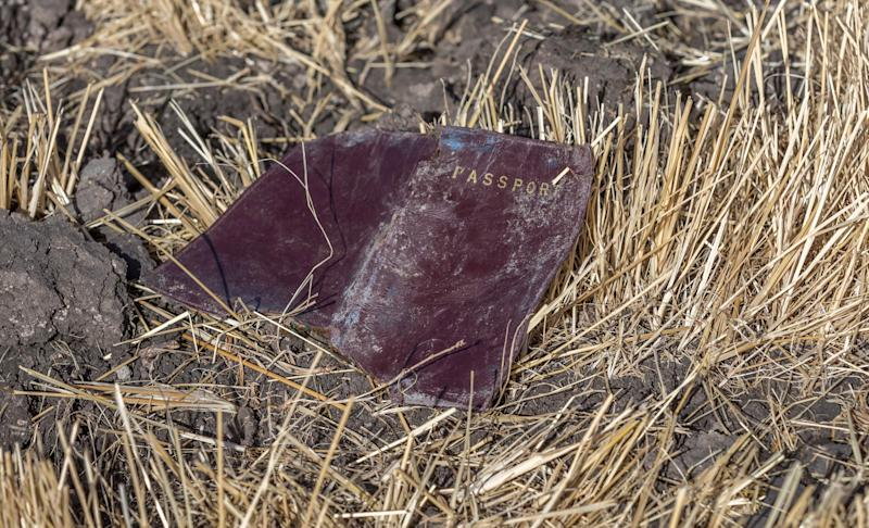 A passenger passport lies on the ground at the scene of an Ethiopian Airlines flight crash near Bishoftu, or Debre Zeit, south of Addis Ababa, Ethiopia, March 11, 2019. (Photo: Mulugeta Ayene/AP)