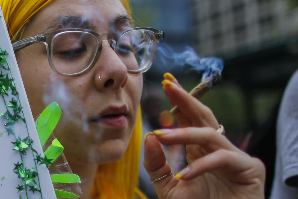 A woman smokes a joint as he attends the World March for Cannabis legalization on May 5, 2018 in Manhattan, New York . (Photo by Eduardo MunozAlvarez/VIEWpress/Corbis via Getty Images)