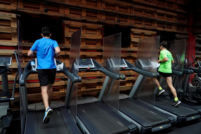 Men run on a treadmill in a gym as Madrid eases lockdown restrictions during phase two following the coronavirus disease (COVID-19) outbreak, in Madrid, Spain, June 8, 2020. REUTERS/Juan Medina