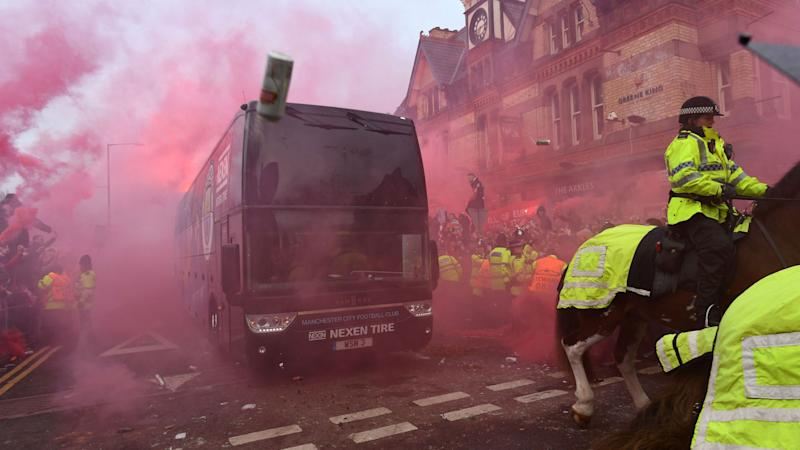 Liverpool charged over Man City bus attack