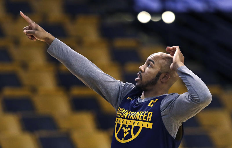 West Virginia's Jevon Carter points towards the scoreboard prior to a practice at the NCAA men's college basketball tournament in Boston, Thursday, March 22, 2018. West Virginia faces Villanova in a regional semifinal on Friday night. (AP Photo/Charles Krupa)
