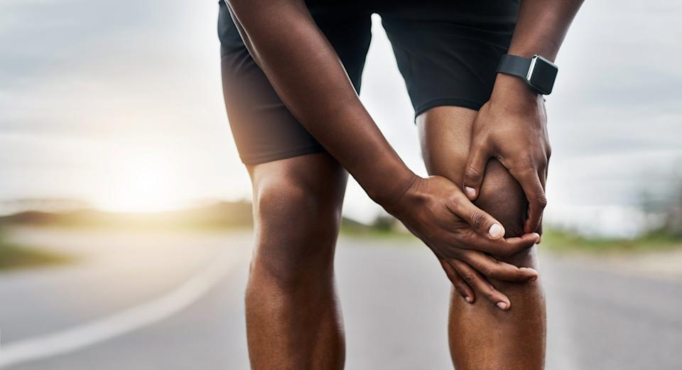 Man massages knee during raceGetty Images