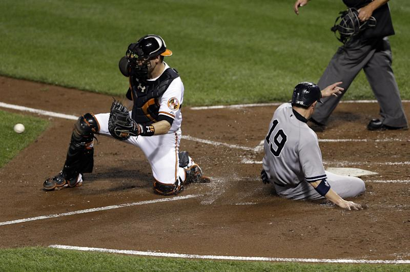New York Yankees' Chris Stewart (19) beats the throw to Baltimore Orioles catcher Matt Wieters as he scores on a double by Alex Rodriguez in the third inning of a baseball game, Tuesday, Sept. 10, 2013, in Baltimore. (AP Photo/Patrick Semansky)