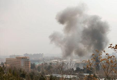 Smoke rises from a military hospital area at the site of blast and gunfire in Kabul