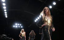 Models wear creations for the Chanel Spring-Summer 2022 ready-to-wear fashion show presented Tuesday, Oct. 5, 2021, in Paris. (AP Photo/Francois Mori)