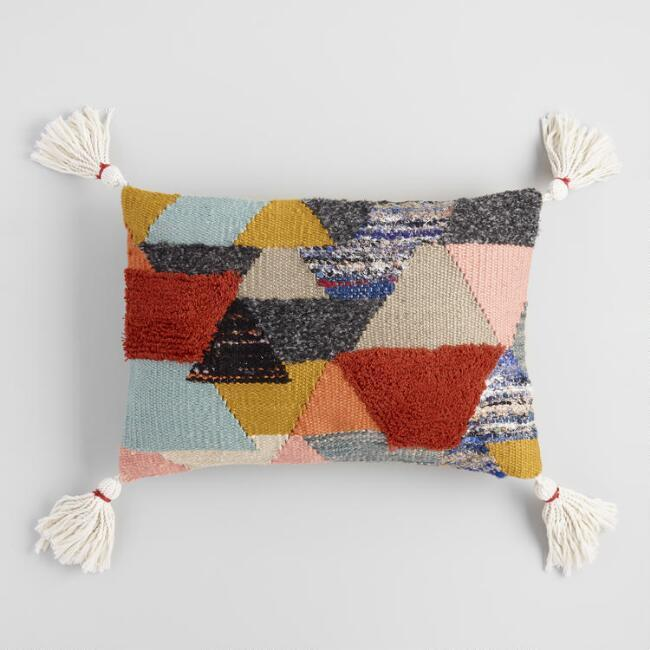 """<strong>Style Says: """"My Flight From Jaipur Landed Last Night"""" </strong><br>Allow this diamond-tufted lumbar pillow to do all the cozy-global talking with its swinging tassels and overall """"artisan-crafted"""" feel.<br><br><strong>Cost Plus World Market</strong> Multicolor Horizon Tufted Lumbar Pillow, $, available at <a href=""""https://go.skimresources.com/?id=30283X879131&url=https%3A%2F%2Fwww.worldmarket.com%2Fproduct%2Fmulticolor-horizon-tufted-lumbar-pillow.do"""" rel=""""nofollow noopener"""" target=""""_blank"""" data-ylk=""""slk:Cost Plus World Market"""" class=""""link rapid-noclick-resp"""">Cost Plus World Market</a>"""