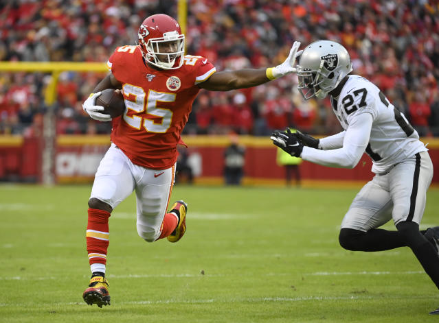 FILE - In this Sunday, Dec. 1, 2019 file photo, Kansas City Chiefs running back LeSean McCoy (25) fends off Oakland Raiders cornerback Trayvon Mullen (27) during the first half of an NFL football game in Kansas City, Mo. Kansas City Chiefs running back LeSean McCoy and his former girlfriend have reached a settlement in a lawsuit she filed against him, court records show, Wednesday, Dec. 4, 2019. Delicia Cordon filed the lawsuit last year accusing McCoy of failing to protect her from a violent July 2018 home invasion at a home he owns in Milton, just outside Atlanta. (AP Photo/Reed Hoffmann, File)