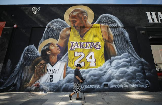 A mural depicting deceased Kobe Bryant and his daughter Gianna, painted by @sloe_motions, is displayed on a building in downtown Los Angeles. (Mario Tama/Getty Images)