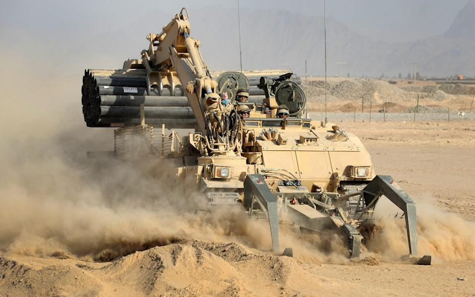 A Trojan vehicle belonging to 5 Armoured Engineer Squadron, cuts through the Helmand dust. - Rupert Frere RLC/Crown Copyright