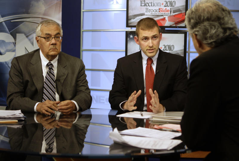 Candidates for Massachusetts Fourth Congressional District incumbent Democrat Rep. Barney Frank, left, and Republican challenger Sean Bielat, center, participate in a taping session for a televised debate hosted by Jim Braude, right, at the television studios of New England Cable News, in Newton, Mass., Monday, Oct. 11, 2010. (AP Photo/Steven Senne)