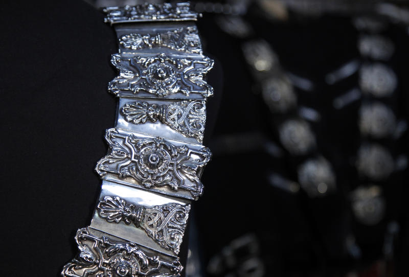 "In this image taken on Thursday, June 21, 2012, a detail of Michael Jackson's belt designed by his longtime costume and clothing designer, Michael Bush, is shown in Los Angeles. Bush tells the King of Pop's style secrets in a new photo-filled book, ""The King of Style: Dressing Michael Jackson"" to be released on October 30, 2012. (AP Photo/Jae C. Hong)"