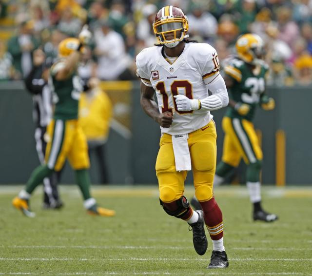 Washington Redskins quarterback Robert Griffin III reacts as he walks off the field after throwing an interception during the first half of an NFL football game against the Green Bay Packers Sunday, Sept. 15, 2013, in Green Bay, Wis. (AP Photo/Mike Roemer)