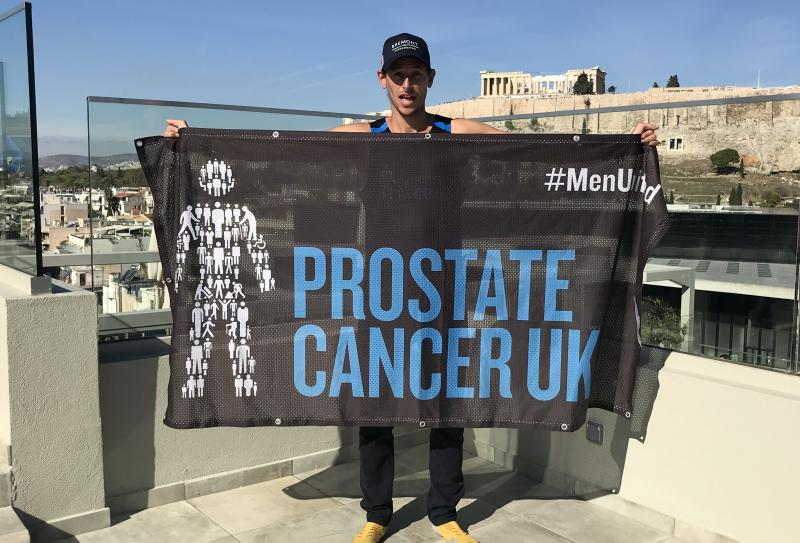 Ultra runner Nick Butter with a Prostate Cancer UK banner