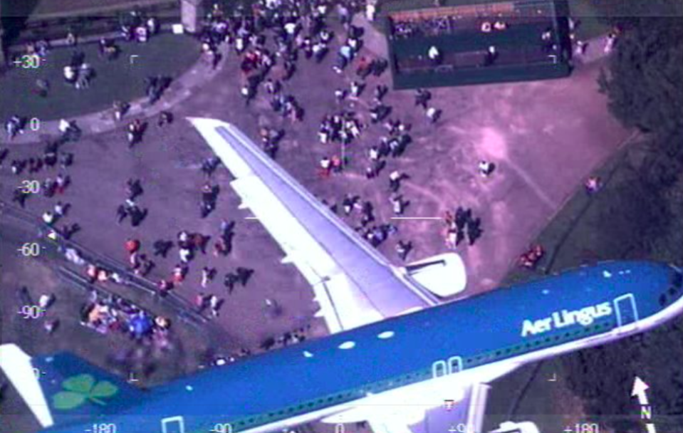 <em>A police helicopter caught an Aer Lingus commercial jet flying over the crowds at the Royal Wedding (Twitter/@NPASBenson)</em>