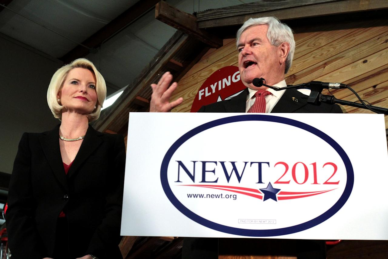 Republican presidential candidate Former House Speaker Newt Gingrich, with his wife Callista, speaks to supporters on a campaign stop Friday, March 9, 2012, at Henderson's Antique Car Barn in Mobile, Ala. Gingrich, a former house speaker from Georgia, gave a three point plan to spark domestic oil and gas production as he denounced Obama policy. (AP Photo/Michelle Rolls-Thomas)