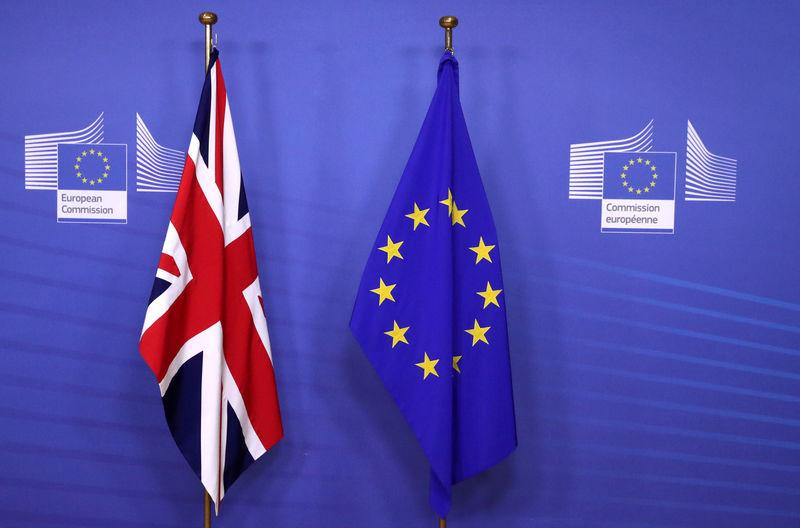 British and EU flags are seen before Britain's Prime Minister Theresa May meets with Commission President Jean-Claude Juncker to discuss draft agreements on Brexit, at the EC headquarters in Brussels