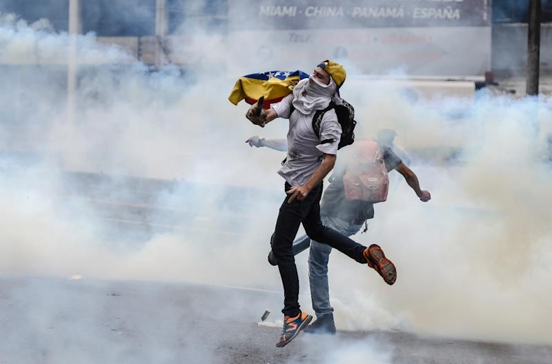 The wave of protests has revived fears of broader unrest in Venezuela, where 43 people were killed during riots in 2014 (AFP Photo/JUAN BARRETO)