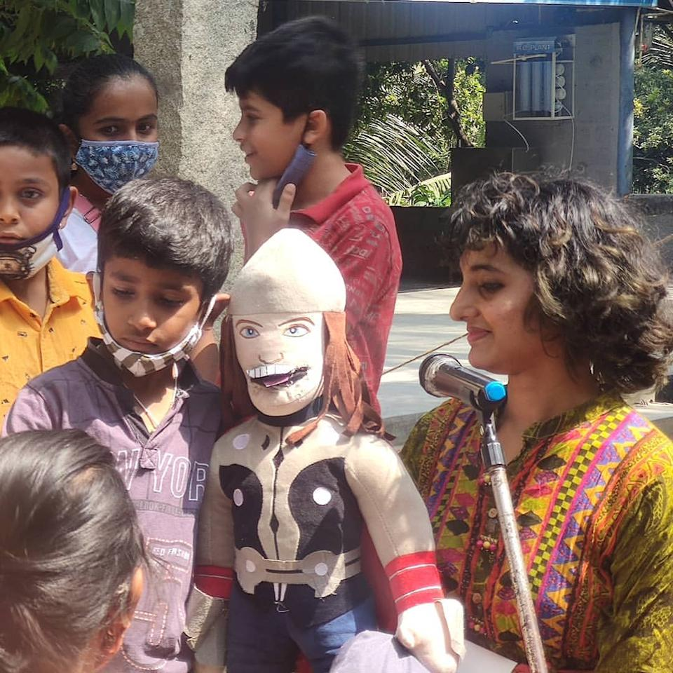 Sharanya entertaining the kids with her puppet at the Ragi Kana event