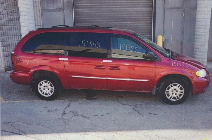 <p>McArthur's 2004 Dodge Caravan after police located it at a wrecking yard in Courice, Ont. Police detected blood and other bodily fluids inside the van that matched the DNA profiles of several of McArthur's victims. (Photo provided by the Crown) </p>
