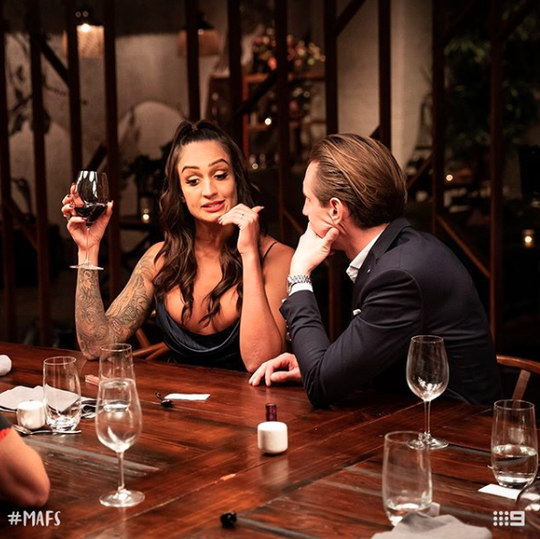Hayley Vernon and Ivan Sarakula at the table talkng on Married At First Sight