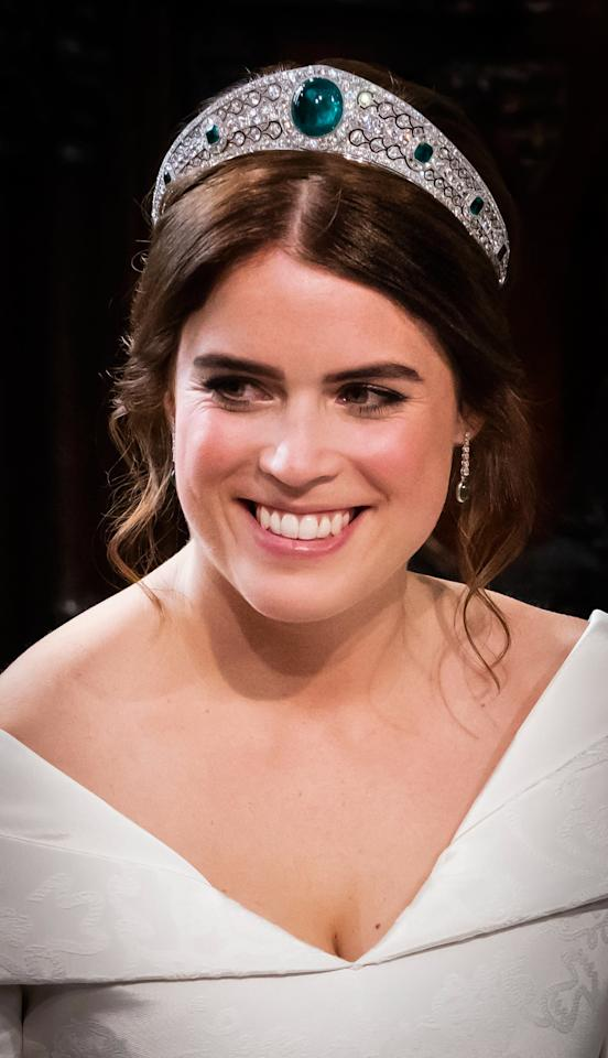 """<p>The tiara, which was never worn <a href=""""https://www.popsugar.com/fashion/Princess-Eugenie-Tiara-Her-Wedding-Day-44526597"""" class=""""ga-track"""" data-ga-category=""""Related"""" data-ga-label=""""http://www.popsugar.com/fashion/Princess-Eugenie-Tiara-Her-Wedding-Day-44526597"""" data-ga-action=""""In-Line Links"""">until the 2018 wedding of Princess Eugenie</a>, originated in a bequest from Dame Margaret Greville to Queen Elizabeth the Queen Mother. It was first created in 1919 and features diamonds and emeralds set in platinum, including a 93.7-carat oval-shaped emerald in the center. Queen Elizabeth II has never worn the tiara, but lent it to her granddaughter Eugenie for <a href=""""https://www.popsugar.com/celebrity/Princess-Eugenie-Jack-Brooksbank-Wedding-Pictures-45301097"""" class=""""ga-track"""" data-ga-category=""""Related"""" data-ga-label=""""http://www.popsugar.com/celebrity/Princess-Eugenie-Jack-Brooksbank-Wedding-Pictures-45301097"""" data-ga-action=""""In-Line Links"""">her wedding to Jack Brooksbank</a>. Jewelry experts estimate its worth to be somewhere between $6.5 million and $13 million.</p>"""