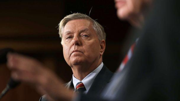 PHOTO: Sen. Lindsey Graham listens as Sen. Robert Menendez speaks during a press conference at the U.S. Capitol, Dec. 20, 2018. Graham, Menendez and Sen. Jack Reed spoke out against President Trump's decision to remove U.S. military forces from Syria. (Win McNamee/Getty Images)