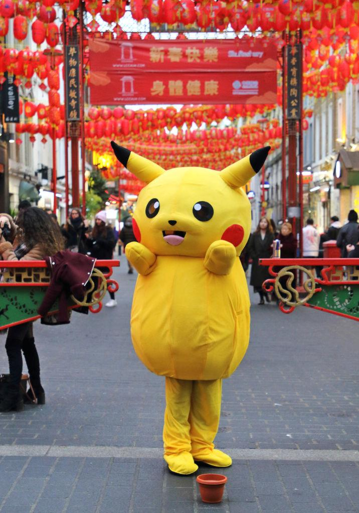 LONDON, UNITED KINGDOM - 2020/01/23: A Pokemon Pikachu character stands at the entrance of Gerrard Street as London's vibrant Chinatown district prepares for Chinese New Year celebrations. (Photo by Keith Mayhew/SOPA Images/LightRocket via Getty Images)