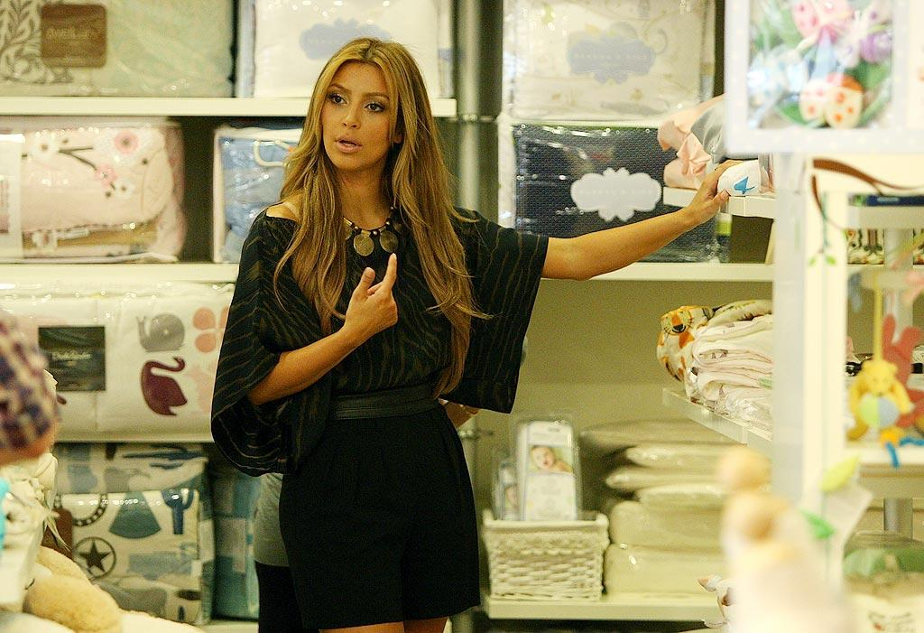 "Kim Kardashian recently broke up with her beau, Reggie Bush, but she seems to be coping with it all right by keeping busy. The reality TV hottie is going behind the camera for a new project, executive producing a new series that follows a pair of publicists. ""Every week we'll have a different celebrity and a different crisis and drama,"" she told ""Access Hollywood."" Frazer Harrison/KA/<a href=""http://www.wireimage.com"" target=""new"">WireImage.com</a> - August 27, 2009"
