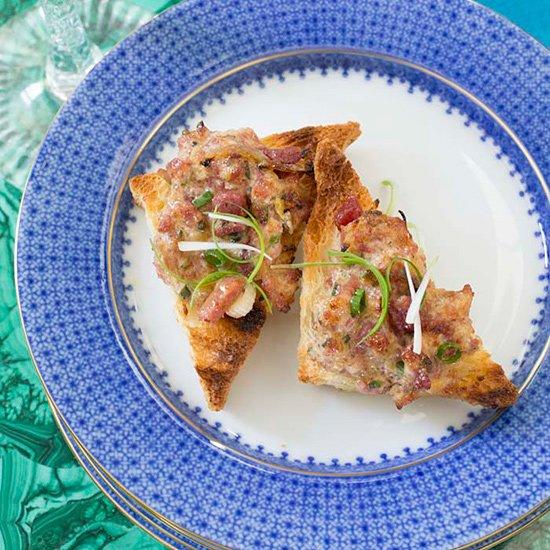 """<p>The secret to keeping the toast crisp? Spread the ham topping on just before baking.</p><p><a href=""""https://www.foodandwine.com/recipes/spiced-ham-and-cheese-toasts"""">GO TO RECIPE</a></p>"""