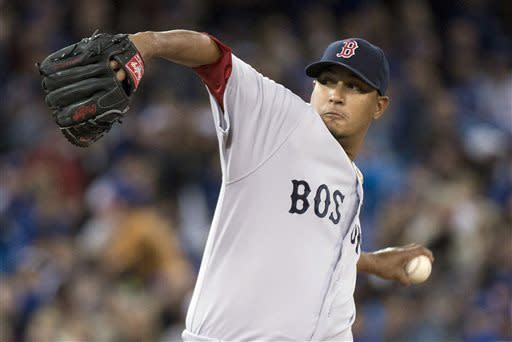 Boston Red Sox starting pitcher Felix Doubront works against the Toronto Blue Jays during first-inning baseball game action in Toronto, Friday, April 5, 2013. (AP Photo/The Canadian Press, Nathan Denette)