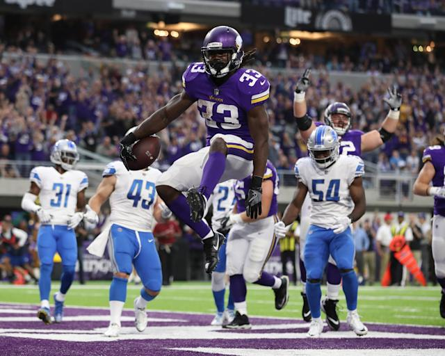 <p>Minnesota Vikings running back Dalvin Cook (33) celebrates after scoring against the Detroit Lions in the first half at U.S. Bank Stadium. Mandatory Credit: Reese Strickland-USA TODAY Sports </p>