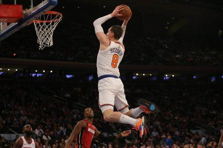 Jan 27, 2019; New York, NY, USA; New York Knicks forward Mario Hezonja (8) dunks against Miami Heat guard Josh Richardson (0) during the fourth quarter at Madison Square Garden. Mandatory Credit: Brad Penner-USA TODAY Sports