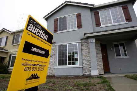 An auction sign is displayed in front of a home in Stockton