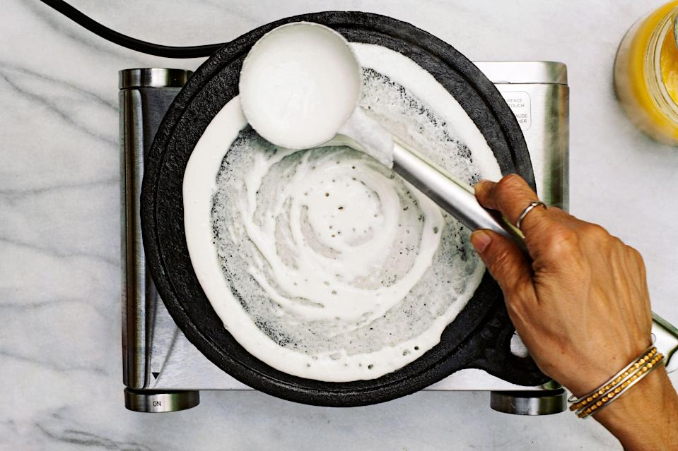 "<h1 class=""title"">Dosa - PROCESS</h1> <div class=""caption""> Use the bottom of the ladle to create rings that are alternately lacey and puffy. </div> <cite class=""credit"">Photo & Food Styling by Tara O'Brady</cite>"