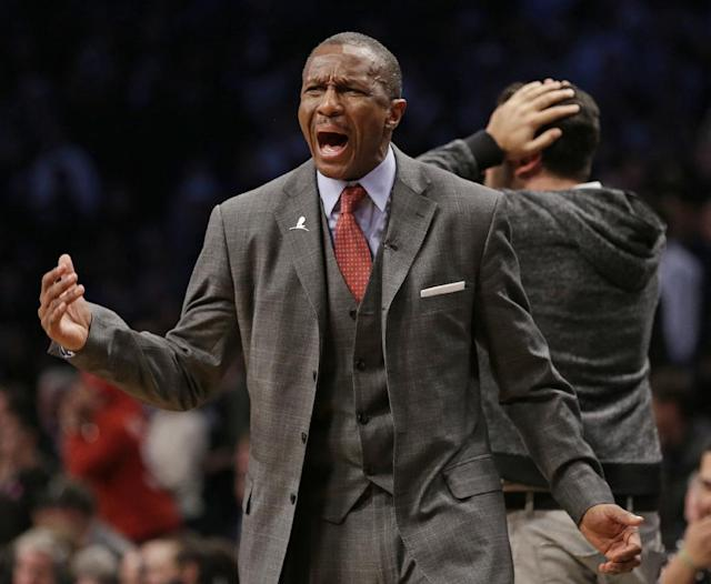 Toronto Raptors coach Dwane Casey reacts to a call during the second half of Game 3 of an NBA basketball first-round playoff series against the Brooklyn Nets on Friday, April 25, 2014, in New York. The Nets won 102-98. (AP Photo/Frank Franklin II)