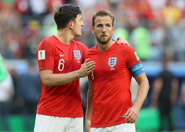 Harry Maguire and Harry Kane embrace