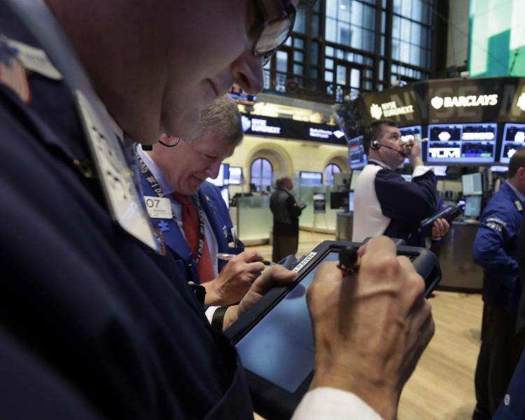 In this Monday, June 10, 2013 photo, traders work on the floor of the New York Stock Exchange. Global stock markets staged a modest recovery Wednesday, June 26, 2013 boosted by strong data releases that portray a U.S. economy on the upswing. (AP Photo/Richard Drew)