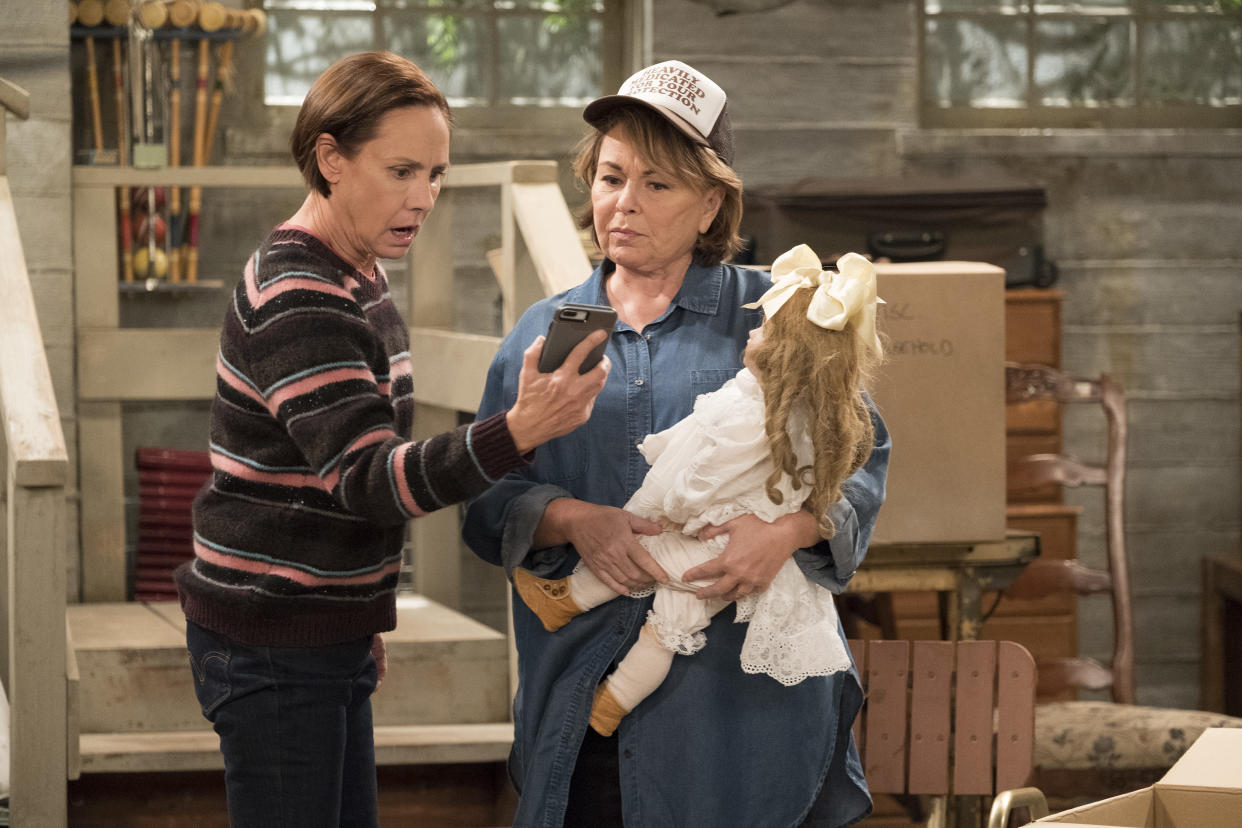 """ROSEANNE - """"Knee Deep"""" - Roseanne's knee gets worse so Dan is forced to a make an important work decision; but when a major storm hits Lanford, their fortunes change for the better. Later, Darlene realizes she has to go back to her first passion . writing, on the ninth episode and season finale of the revival of """"Roseanne,"""" TUESDAY, MAY 22 (8:00-8:30 p.m. EDT), on The Walt Disney Television via Getty Images Television Network. (Adam Rose via Getty Images) SARA GILBERT, ROSEANNE BARR"""