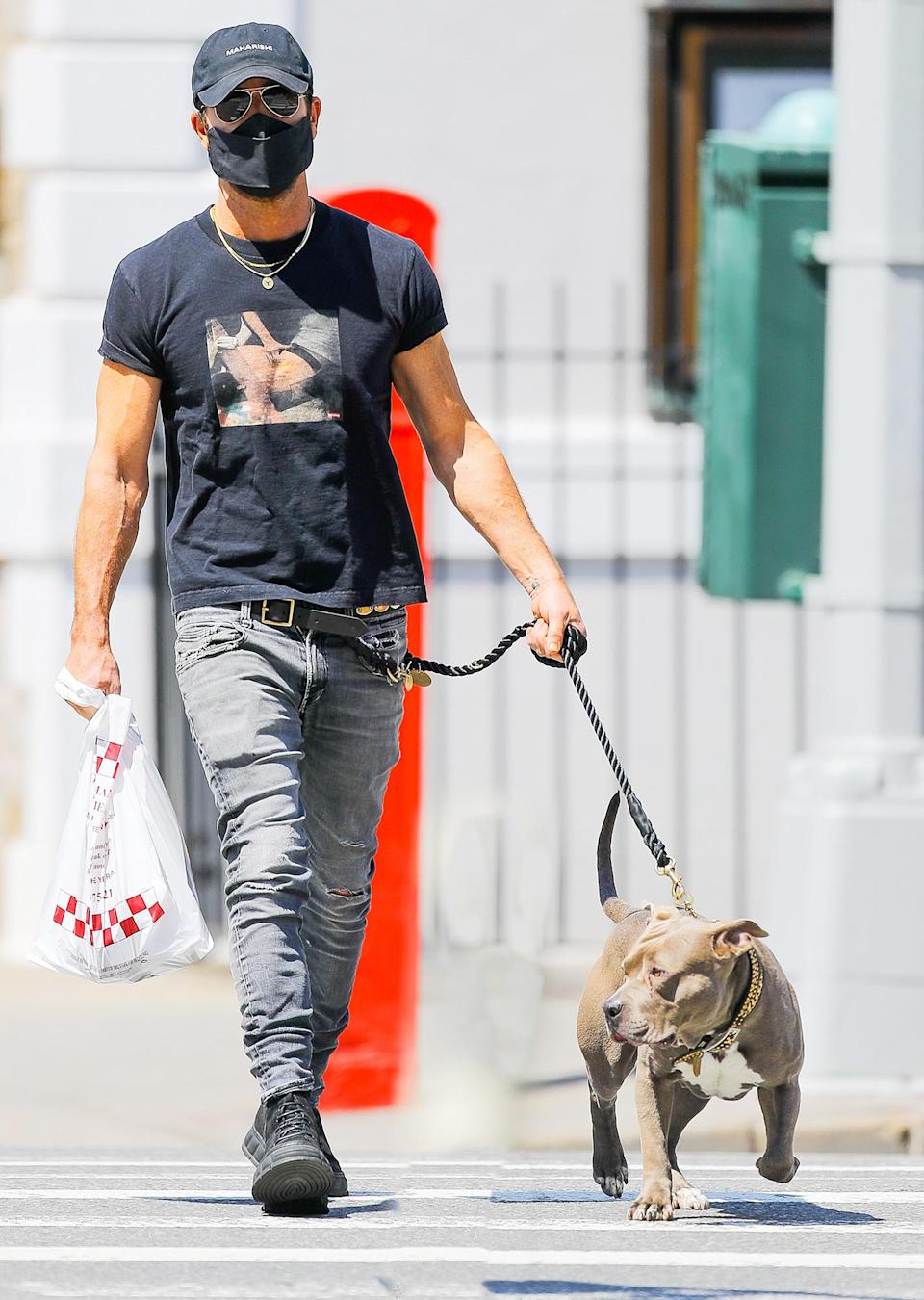 <p>Justin Theroux takes his pup Kuma out for a walk to enjoy the spring weather on Wednesday in N.Y.C.</p>