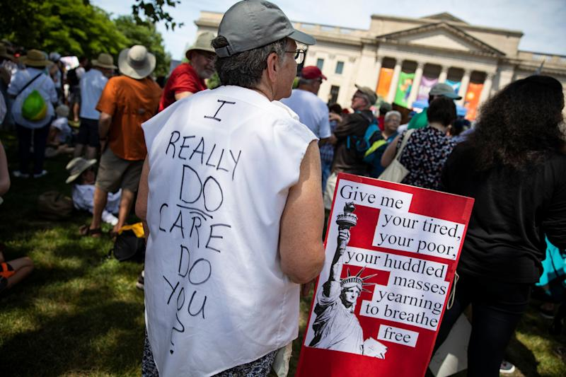 A protester wears a shirt in reply to a jacket worn by First Lady Melania Trump during a rally against US President Donald Trump's immigrant family separation policies in Philadelphia, Pennsylvania, June 30, 2018. - Thousands of demonstrators, baking in the heat and boiling mad against US immigration policy, marched across the country Saturday. June 30, 2018, to protest the separation of families under President Donald Trump's hardline policy. (Photo by DOMINICK REUTER / AFP) (Photo credit should read DOMINICK REUTER/AFP/Getty Images)