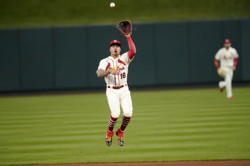 St. Louis Cardinals second baseman Kolten Wong leaps in the air to catch a line drive by Milwaukee Brewers' Ryan Braun during the sixth inning of a baseball game Saturday, Sept. 26, 2020, in St. Louis. (AP Photo/Jeff Roberson)