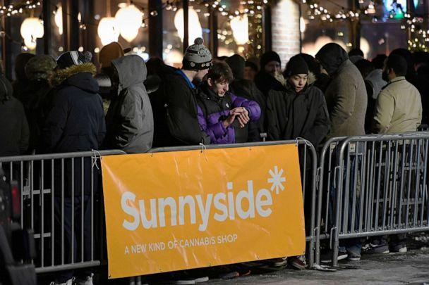PHOTO: A long line of people brave the cold as they wait to be the first in Illinois to purchase recreational marijuana at Sunnyside dispensary, Jan. 1, 2020, in Chicago. (Paul Beaty/AP)
