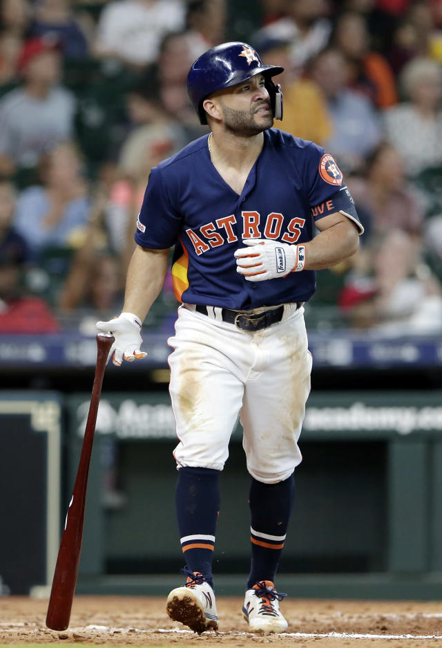 Houston Astros second baseman Jose Altuve flips his bat as he watches his home run hit during the fifth inning of a baseball game against the Texas Rangers Sunday, July 21, 2019, in Houston. (AP Photo/Michael Wyke)