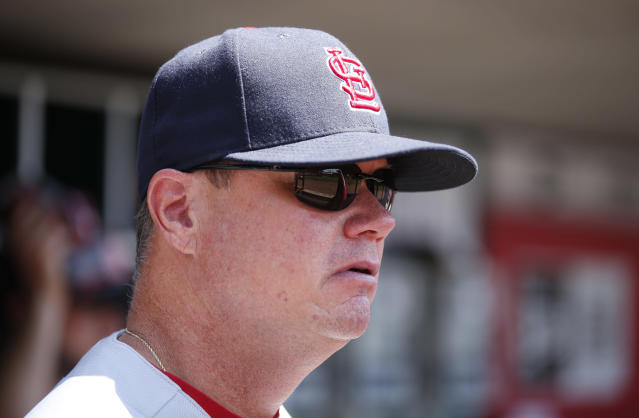 St. Louis Cardinals interim manager Mike Shildt (8) watches from the dugout during the first inning of a baseball game against the Cincinnati Reds, Wednesday, July 25, 2018, in Cincinnati. (AP Photo/Gary Landers)
