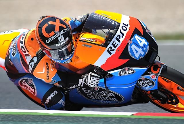 Estrella Galicia's Portuguese Miguel Oliveira takes a curve at the Catalunya racetrack in Montmelo, near Barcelona, on June 1, 2012, during the Moto 3 second training session the Catalunya Moto GP Grand Prix. AFP PHOTO/LLUIS GENELLUIS GENE/AFP/GettyImages