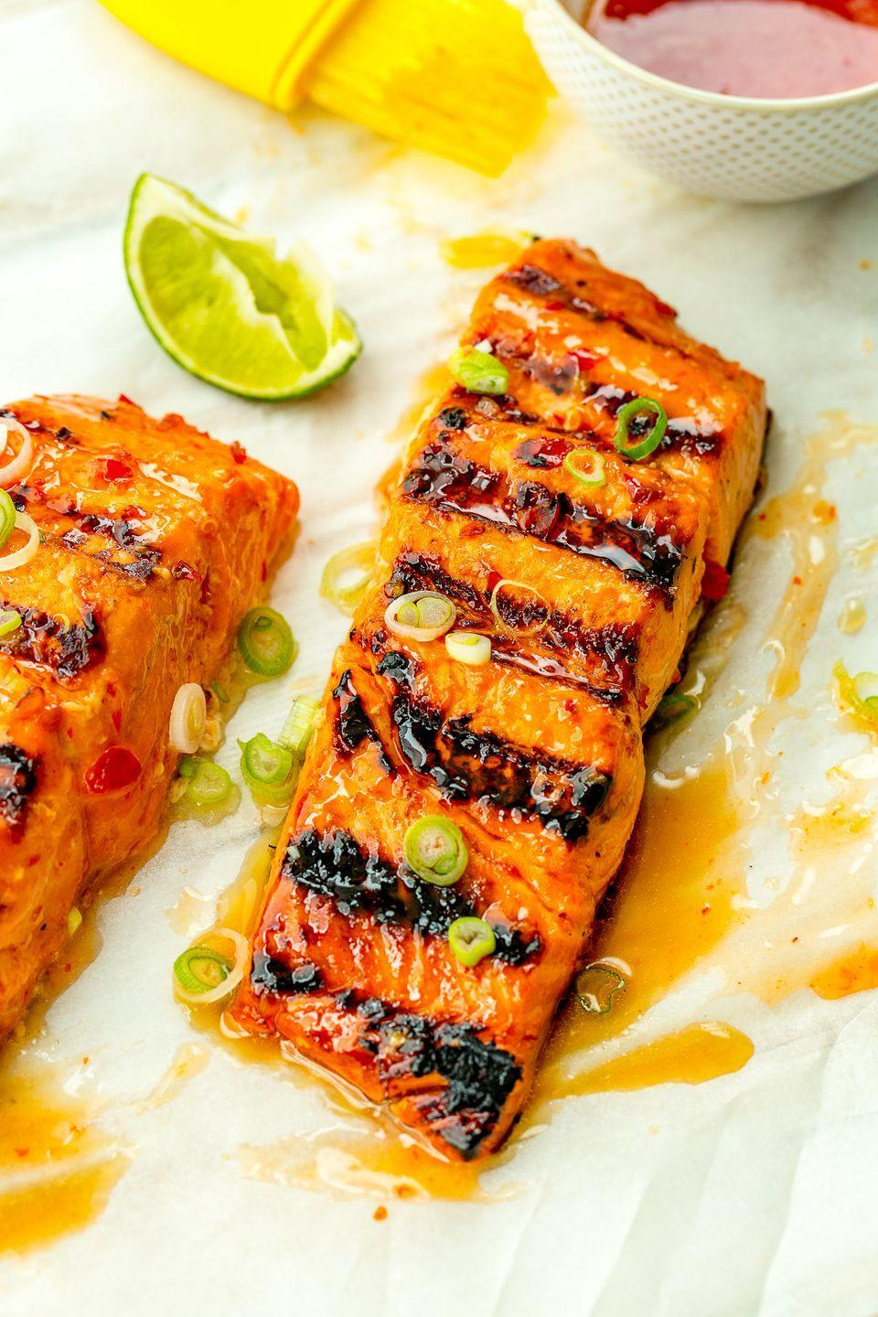 "<p>Amp up your grill game with this zesty glazed salmon.</p><p>Get the recipe from <a href=""https://www.delish.com/cooking/recipe-ideas/recipes/a47374/sweet-chili-lime-grilled-salmon-recipe/"" rel=""nofollow noopener"" target=""_blank"" data-ylk=""slk:Delish"" class=""link rapid-noclick-resp"">Delish</a>.</p>"