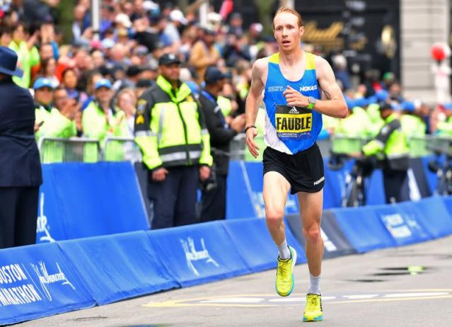Scott Fauble cf the U.S.A. crosses the finish line in seventh place during the 123rd running of the Boston Marathon on the sixth anniversary of the 2013 Boston marathon bombings in Boston